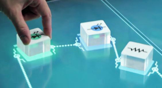 Still image from video demo of an electronic circuit building tool.